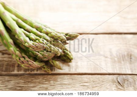 Bunch Of Green Asparagus On Grey Wooden Table