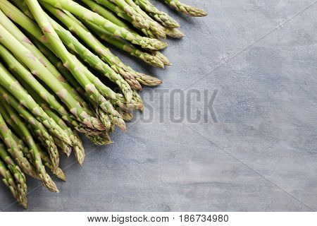 Green asparagus on the grey wooden table