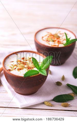 Traditional Indian Lassi Curd With Cardamon, Mint And Saffron