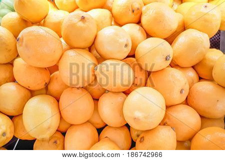 A pile of yellow lemons for background