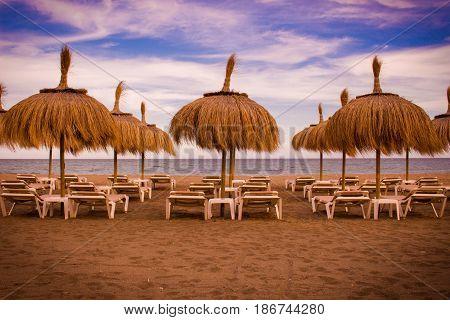 Beach umbrella. Beautiful summer view. Costa del Sol, Andalusia, Spain.