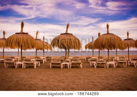 Beach umbrella. Beautiful summer view. Costa del Sol, Andalusia, Spain.