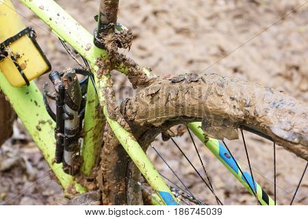 Mountain bike cyclist riding on a muddy road / Cycling in wet condition concept