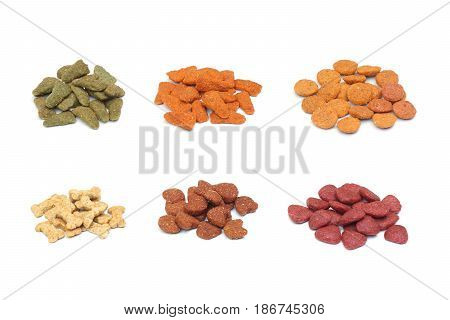 Piles of different types of dog food pellets