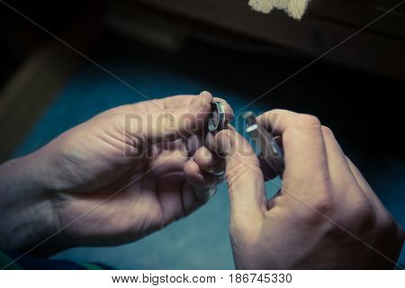 Process of wedding ring crafting. Goldsmith working on wedding rings.