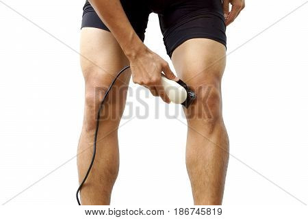A professional cyclist shaving his legs using hair clipper for improving aerodynamics isolated