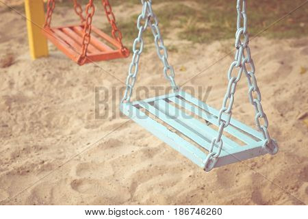 Swing in a playground for kids / Outdoor playground