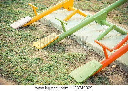 Colorful seesaw in outdoor playground for kids