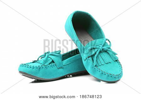 A pair of blue moccasins isolated on white