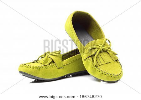 A pair of yellow moccasins isolated on white
