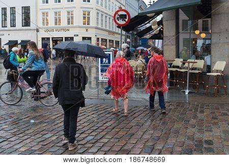COPENHAGEN DENMARK - AUGUST 3 2016: Pedestrian zone in the center of the city on a rainy day