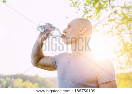 athlete is refreshing himself with water, sport and healthy lifestyle