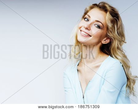 young blond woman on white backgroung smiling gesture thumbs up, isolated emotional posing closeup, lifestyle people concept