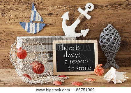 Blackboard With Nautical Summer Decoration And Wooden Background. English Quote There Is Always A Reason To Smile. Fish, Anchor, Shells And Fishnet For Maritime Contex.