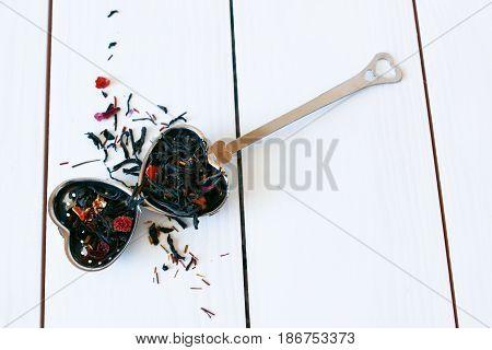 Loose Leaf Black and Herbal Tea with Metal Infuser.