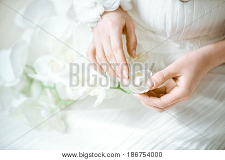 Beautiful bride is holding a wedding colorful bouquet. Beauty of colored flowers. Close up bunch of florets. Bridal accessories. Female decoration for girl. Details for marriage and for married couple
