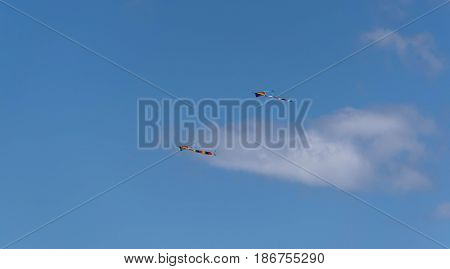 Two Kites-two colorful kites with long tails, flying up in the sky