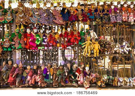MANDALAY,MYANMAR - MARCH 6, 2017: Hand Made Puppets, traditional handicrafts are sold at public street shop in Mandalay on March 6, 2017. Myanmar. (Burma)