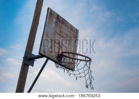 Old ruined basketball hoop in poor neighborhood