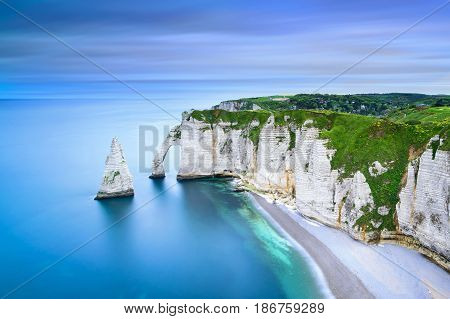 Etretat Aval cliff rocks and natural arch landmark and blue ocean. Aerial view. Normandy France Europe.