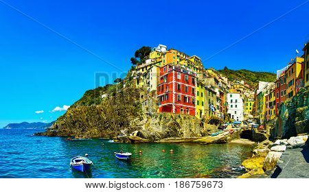 Riomaggiore town cape and sea landscape. Seascape in Cinque Terre National Park Liguria Italy Europe.