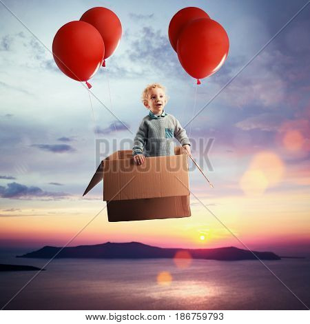 Child looks at the landscape from a hot-air balloon