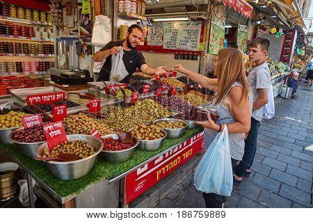 People Buy Foodstuff At The Jerusalem Mahane Yehuda Local Market
