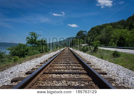 Railroad Tracks Leading into the Mountains in the distance