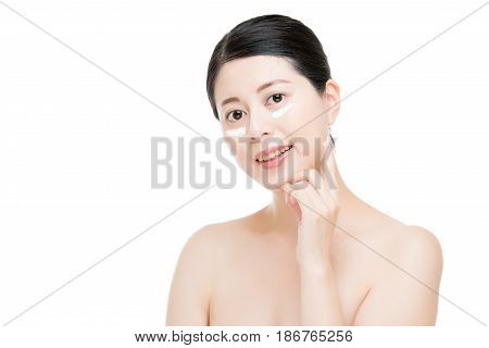 Model Applying Cosmetic Cream Treatment