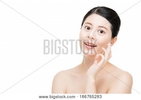 Model Applying Cream Treatment On Her Face
