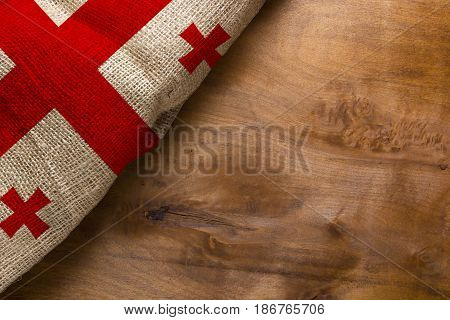 White-red flag of Georgia on a wooden background.