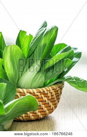 close up Fresh baby green bok choy in basket