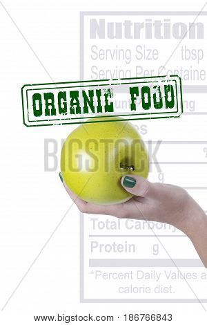 A green apple in a woman's hand a poster with a stamped seal Organic food