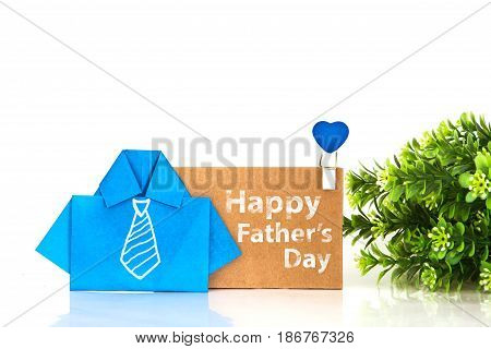 blue origami shirt paper with white hand drawing necktie and Happy Father's day message on brown paper tag creative Father's day decoration concept