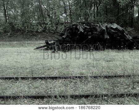 Black and white railway and rail ties piled in by gone days.