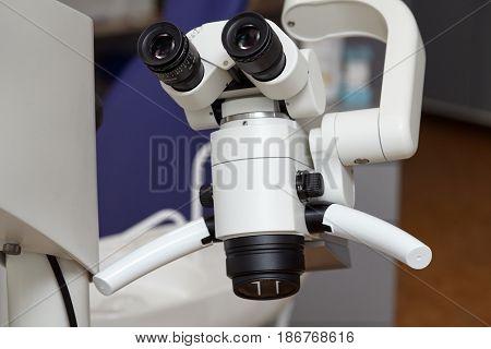 Professional medical dental binocular microscope in the dentist's office