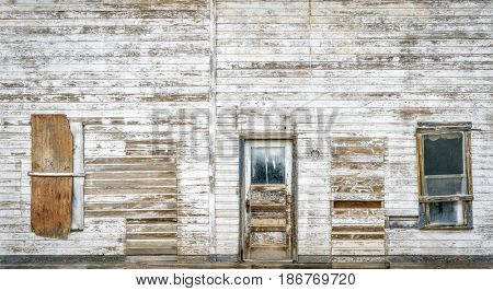 front facade of old abandoned building in a ghost town of eastern Utah