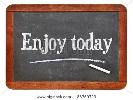 Enjoy today - white chalk text on a vintage slate blackboard