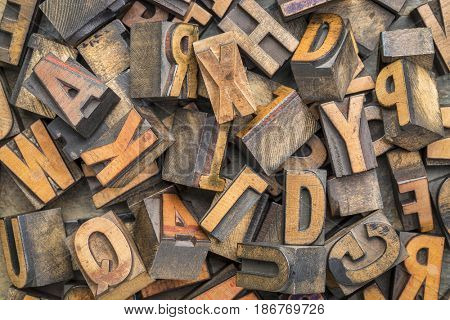 alphabet abstract - background of random letterpress wood type printing blocks, top view
