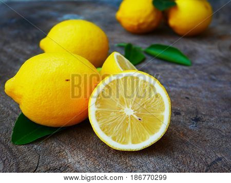 fresh lemons on wood table.Fresh citrus fruit background,Fresh lemon on background