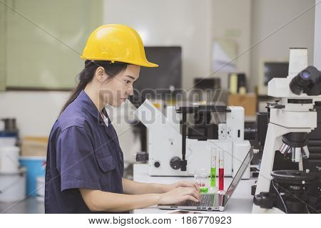 Scientist or engineer woman doing chemical test in laboratory
