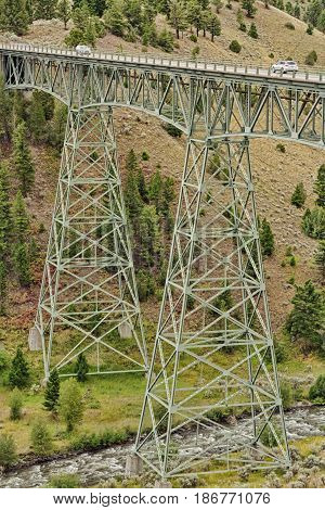 Portrait landscape of cars on the Grand Loop Trestle Bridge Yellowstone National Park Wyoming USA.