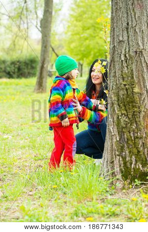 Mother and son having conversation after the tree in park