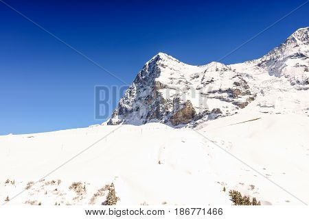 Beautiful Alps Mountain with blue sky background at Jungfrau Switzerland.