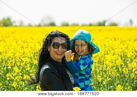Mother and child posing in rape and the boy giving thumbs