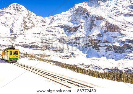 Jungfraujoch Switzerland - April 29 2017: Old style trains among the mountains near Kleine Scheidegg Station at Jungfrau Switzerland.