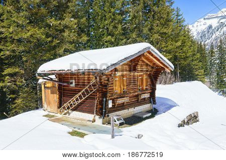 small wooden traditional alpine cabin in the mountains of the Switzerland Alps Switzerland.