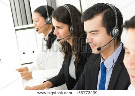 Business people working in call center as telemarketers or customer supporting team