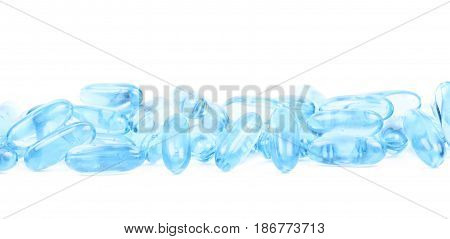 Pile of blue softgel pills isolated over the white background