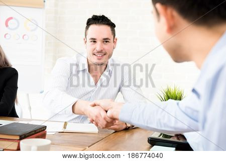 Casual businessmen making handshake in the meeting